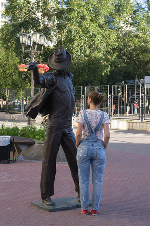 choreographer: Yekaterinburg Russia - July 10, 2016: The girl next to the statue of Michael Jackson street Weiner