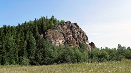noon: Cliff Alikaev Stone which was filmed a scene from the film Shadows at Noon. Stock Photo