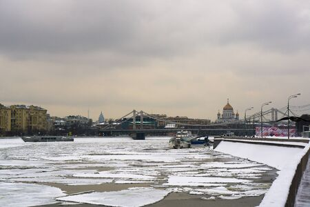crimean: Crimean and Crimean bridge embankment in Moscow in the winter on a cloudy day Stock Photo