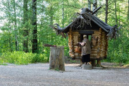 Fairy-tale characters Baba Yaga near the hut on chicken legs