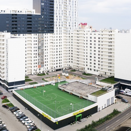 Yekaterinburg, Russia - August 01, 2017: Sports playground in the courtyard of a residential modern house in Yekaterinburg