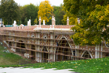 Moscow, Russia - October 09, 2017: Restoration of the Greenhouse Bridge in the Tsaritsyno Museum-Reserve in Moscow