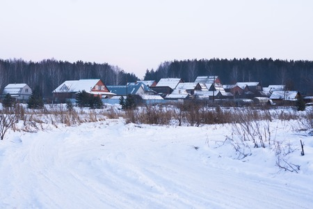Private houses in the Russian village in winter Stock Photo