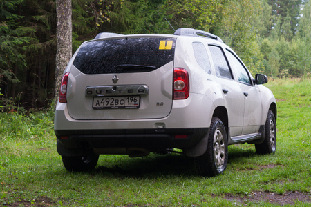 Staroutkinsk, Russia - 18 August, 2018: White crossover Renault Daster stands in rainy weather in the Natural Park Chusovaya River