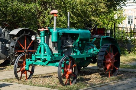 Orenburg, Russia - 26 August, 2018: Retro tractor named Universal of Vladimir Tractor Plant is presented at the exhibition in the Frunze park in the city of Orenburg in Russia