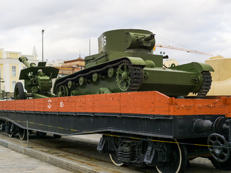 Verkhnyaya Pyshma, Russia - October 20, 2018: A tank on a railway platform as part of an exposition with a retro steam train in the museum of military equipment in the city of Verkhnyaya Pyshma in Russia Editorial