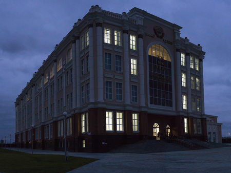 Verkhnyaya Pyshma, Russia - October 20, 2018: The building of the museum of automobile technology of the twentieth century in the evening in the town of Verkhnyaya Pyshma in Russia