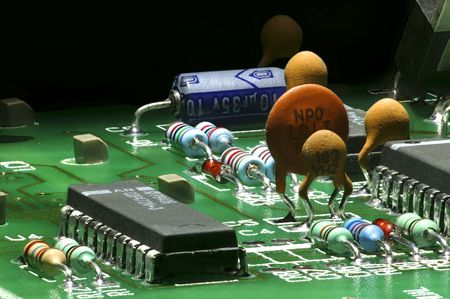 Electronic components mounted on a PC board Stock Photo - 6229535