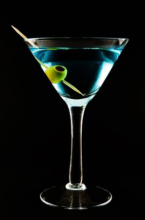 Blue martini with olive garnish Stock Photo