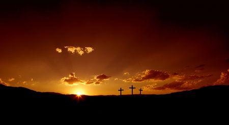 three: Sun rising on three Christian crosses. Stock Photo