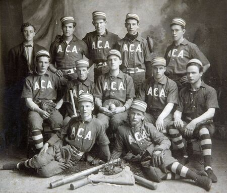 FULTON, NY - JUNE 5, 1903:  Historic image of a baseball team in period uniforms with turn of the century equipment posing for a team photograph.