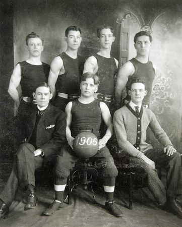 historic and vintage: FULTON, NY-1906:  Historic image of a basketball team with vintage uniforms and equipment posing for a team photograph. Editorial