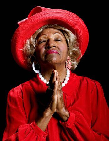 Beautiful African-American woman worshiping in prayer and praise.
