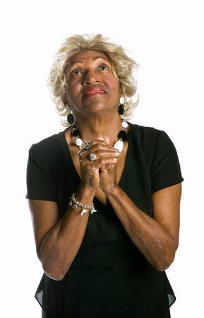 Beautiful African-American woman worshiping in prayer and praise. photo