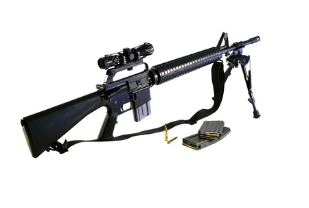assault: Standard US Army AR-15 A2 Assault rifle fitted with barrel bipod and Chinese SKS telescopic site. Stock Photo