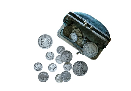 old quarter: Depression era and WWII U.S. coins spilling out of a period coin purse Stock Photo