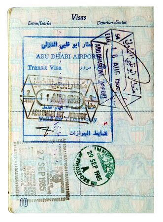 exit and entry stamps and a Visa stamp inside a passport photo