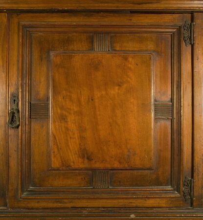 keylock: An antique cupboard door with brass keylock and hinges