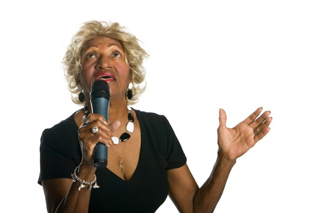 african worship: Beautiful African-American singer holding a wireless microphone and singing praise songs
