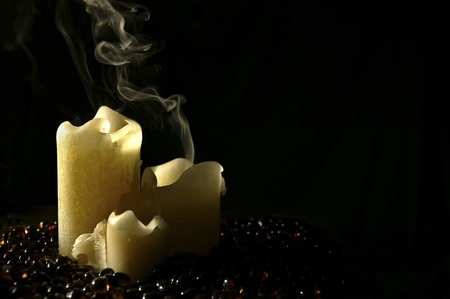 extinguish: Smoke from a three piece candle set Stock Photo