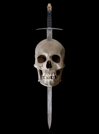 old people: A medieval broadsword thrust through the top of a human skull Stock Photo