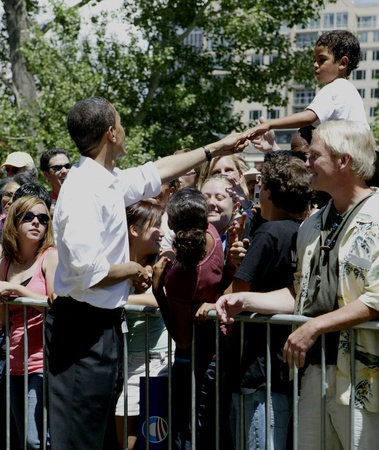 obama: Barak Obama shaking hands in Reno