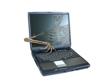 hijacked: An image of a skeleton inside a computer  Stock Photo