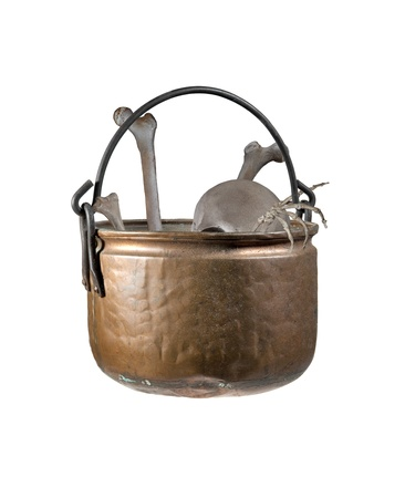 grisly: An old copper witches cauldron filled with human bones Stock Photo