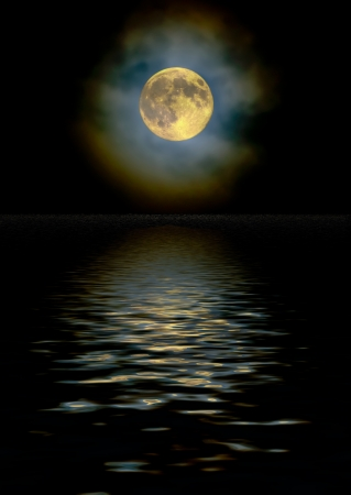 diffraction: Harvest moon as seen through a high, light cloud layer with ice crystal light diffraction reflecting off a water surface