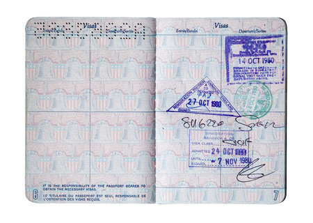 Exit and entry stamps and a Visa stamp for Thailand and Singapore inside a U S  passport  Includes clipping path