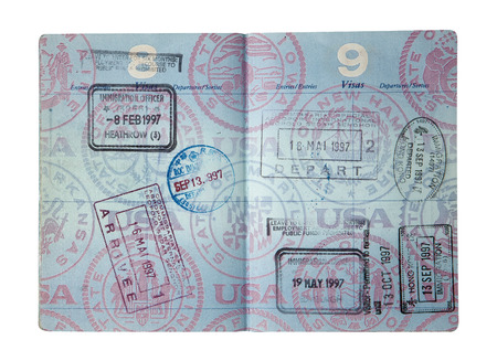 Exit and entry stamps and a Visa stamp for England, Hong Kong, Senegal and Taiwan inside a U S  passport  Includes clipping path