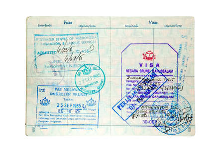 RENO, NEVADA - DECEMBER 29, 2007: Exit and entry stamps for Brunei and the Federated States of Micronesia inside a U.S. passport. Includes clpiipng path.