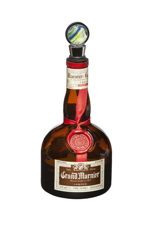 bitter orange: RENO, NEVADA - AUGUST 12, 2014: A bottle of Grand Marnier liqueur from France with a fancy glass stopper. Grand Marnier is an orange-flavored cognac liqueur made of Cognac brandy, distilled essence of bitter orange and sugar. Editorial