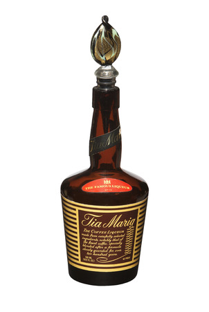 liqueur bottle: RENO, NEVADA - AUGUST 12, 2014: A bottle of Tia Maria, a dark coffee liqueur from Jamaica. Made from Jamaican rum, coffee, vanilla and sugar.
