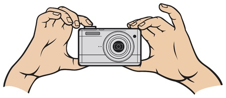 zoom in: camera in hands digital photo camera camera in hands, compact digital camera