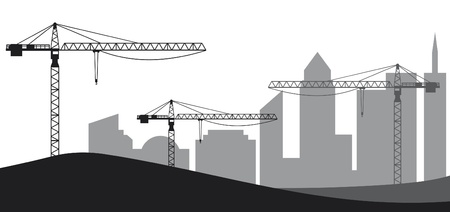 job site: Construction site, cranes and silhouette of the city