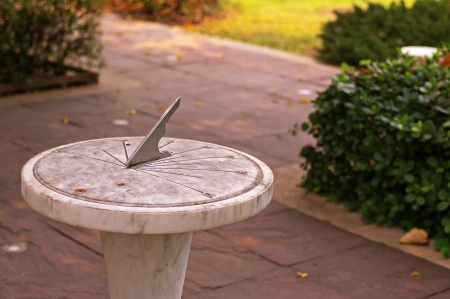 sundial made of marble in the garden