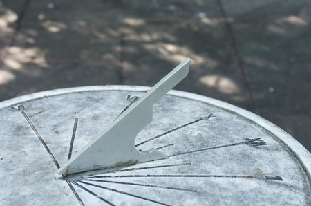 Sun Dial made of stone in the garden Stock Photo