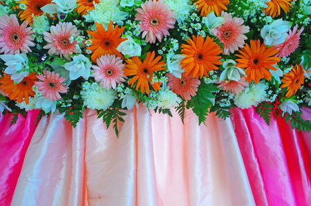 Many flowers included gerbera and chrysanthemum decorated on the colorful cloth