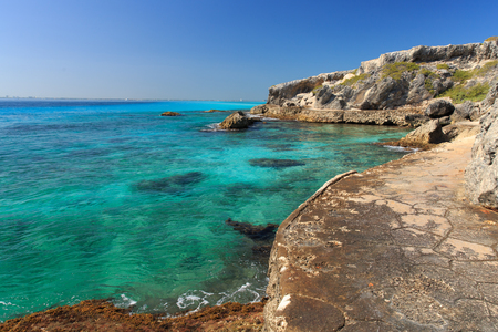 A trail winds around the beautiful blue Caribbean water on Isla Mujeres, Mexico. Stock Photo