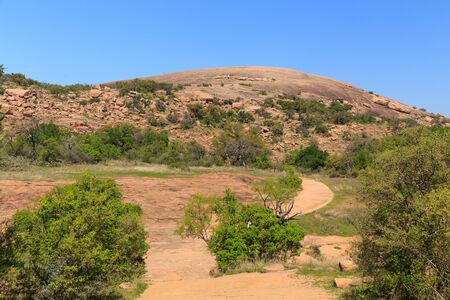 A trail to take you to the top of Enchanted Rock State Park outside of Fredericksburg, Texas. Фото со стока