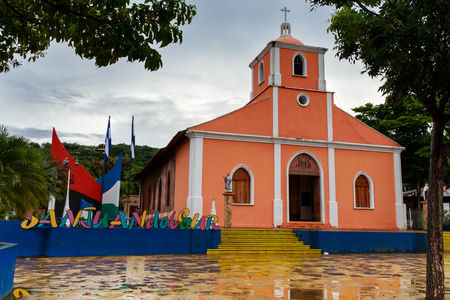 San Juan del Sur sign next to church in Nicaragua. Фото со стока