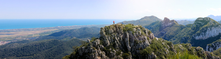 Mountain climber overlooking the panoramic Mediterranean sea