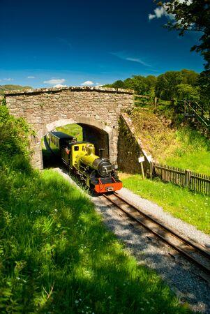 ratty: perkins steam train exits bridge