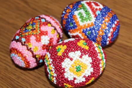 handwork: Beautiful easter eggs decorated with beads  Handwork Stock Photo