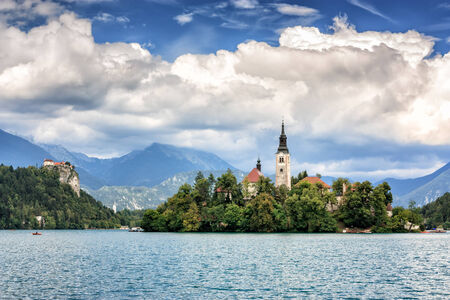 karavanke: View of Lake Bled located in Slovenia Europe  There is St  Mary´s Church of the Assumption on the Island and ancient castle on top of a rock