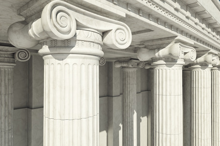 justice: Close-up shot of a line of Greek-style columns. Stock Photo