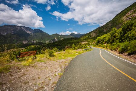 Mountain road. Bench with viewpoint Stock Photo
