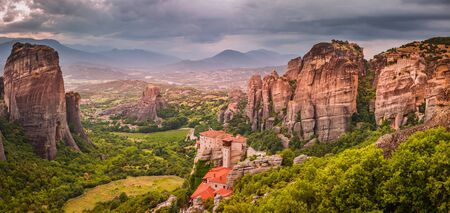 The Holly Monastery of Rousanou and St. Nikolaos Anapafsas Monastery in background.