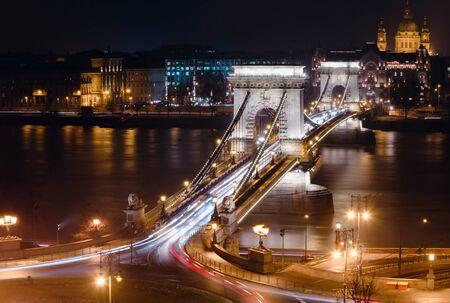 Budapest Szechenyi Chain Bridge at night. Panoramic view on the bridge from Buda hill. The 2019 year.